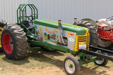 A pulling tractor with a sweet paint job.